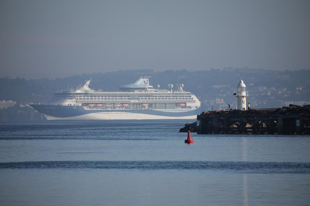 A cruise ship in the distance from Brixham harbour